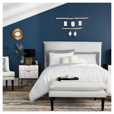 The Nate Berkus Fall Bedroom Collection gives a room a luxurious feel by playing up geometric patterns on bedding, furniture and unique home decor pieces. Pick a single item, like a welcoming ottoman for the foot of the bed, or redo your whole room.