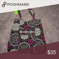 Vera Bradley Tote. NWT Vera Bradley tote bag. 13 inches wide x 151/2 inches long.snap magnetic closure. With two additional pockets one on front and one inside. Magenta Cannaberry print. Smoke-free pet friendly home Vera Bradley Bags Totes