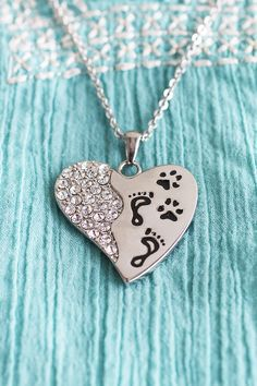 """""""Pets have a way of finding the people who need them the most, filling an emptiness they don't even know they have.""""  The sweet, touching sentiment is imprinted on the back of our sparkling, stainless steel heart-shaped necklace. Paw prints side-by-side with footprints on the front illustrate how close your bond is with your pet who's always by your side."""