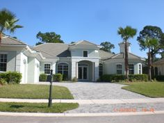 9324 SCARBOROUGH COURT, PORT ST. LUCIE, FL $429,000. VIEWS OF THE LAKE AND GOLF COURSE. GREGORY H. DALESSIO, RE/MAX 100 RIVERSIDE, PORT ST. LUCIE REAL ESTATE
