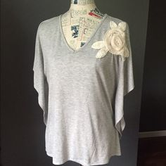 Chelsea & Violet soft gray T-shirt Adorable Flower design on the shoulder. Amazingly soft and great quality. Gently worn and in good condition!  Sides are stitched with a dolman sleeve. Chelsea & Violet Tops Tees - Short Sleeve