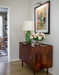 Green lamp, oak floor and beautiful rich coloured grain in sideboard | Cush and Nooks