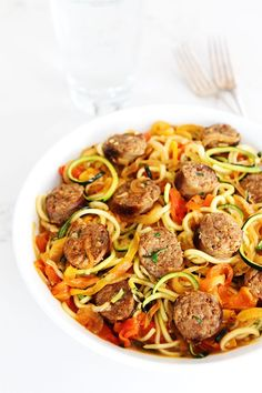 Looking for healthy zucchini recipes? Make this Sausage and Peppers with Zucchini Noodles. It's sweet and spicy Italian sausage with peppers onions and zucchini noodles in a simple garlic tomato sauce. This healthy dinner makes veggies fun to eat! Zucchini Noodles With Pesto, Zucchini Noodle Recipes, Zoodle Recipes, Veggie Noodles, Pasta Recipes, Healthy Zucchini, Sausage Recipes, Sausage And Peppers, Spicy Sausage