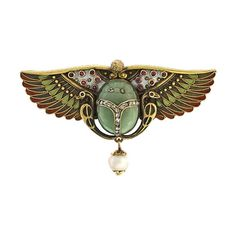 5K yellow gold Egyptian revival pin featuring a central scarab motif in carved idocrase set with rose cut diamonds with a pearl drop and brightly enameled wings set with small rubies. Pristine Condition. Circa 1925.