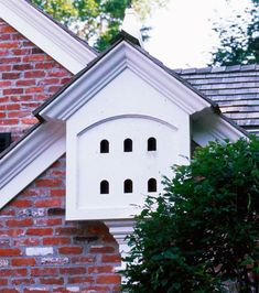 A built-in birdhouse in the eave over the garage! Smart and cute