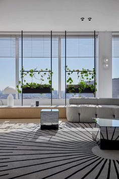 To take full advantage of the natural light from the wrap-around views of Sydney's skyline from the 200-metre building, The Stella Collective opted for an open-plan layout. Large planes of steel-framed glazing is used in place of partition walls between office space and meeting rooms.