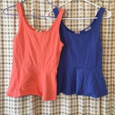 Express peplum tank tops Coral and a purple peplum express tanks top! In great condition only worn once! Can dress them up or down and great for every occasion!both are included! Express Tops Tank Tops