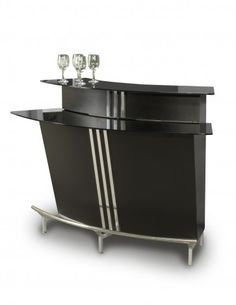 This Two Tiered Broadway Bar by Chintaly Imports is stylish and contemporary with its curved design. Shelves and racks make it easy to store bottles and glasses inside the bar. Beautiful chrome accents and stainless steel footrest. It has 3 built-in shelv Home Bar Sets, Bars For Home, Contemporary Bar, Modern Bar, Home Bar Table, Bar Tables, Dining Tables, Coffee Tables, Chintaly Imports