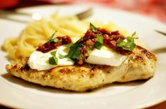 Chicken Bryan  Topped with goat cheese, sundried tomatoes and a basil lemon butter sauce.