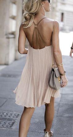 nude pleated dress. Chloe Drew bag.