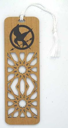 Gorgeous 'Hunger Games'-inspired engraved wooden bookmark ($9.99 on Etsy) http://sulia.com/channel/the-hunger-games/f/5fc1b3b2-c5e5-4927-af99-c077515dda17/?pinner=39289531