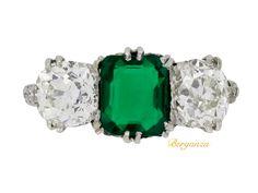 Colombian emerald and diamond three stone ring, circa 1910.