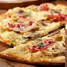 This think pizza crust recipe makes one 12-14inch pizza crust that bakes up nice and crispy.. Thin Pizza Recipe from Grandmothers Kitchen.