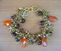 Charm braclet- leaves, faceted chalcedony chunks, coral and wood. $62.00, via Etsy.