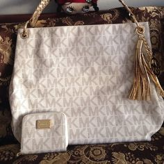 ✨AUTHENTIC MICHAEL KORSS bundle ✨ Lightly used vanilla signature braided strap bag with gold lining inside and gold hardware  in excellent conditions very clean no stains and no damage minimal discolorations under the strap and scratches on metal logo of the wallet . Mk tassel its brand new no scratches please look at all the pictures ✨I'm open to offers✨ Michael Kors Bags Shoulder Bags