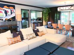 The contemporary Asian living room features low, clean-lined furnishings, accents of bamboo and a fun piece of sushi artwork.