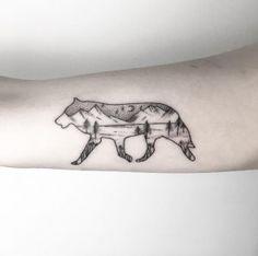 Landscape wolf tattoo by Maria Fernandez