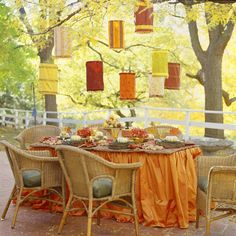 A floor length table cloth can really dress up any table. The added lanterns above make it a fun and festive space - a little pizzazz.
