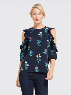 We're obsessed with our Tisdale Floral print: Bright pops of pretty spring flowers perfectly accent a cool navy ground. This cute cold-shoulder top, with its flirty, feminine details, is an instant fave around Draper James headquarters.