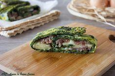 Rotolo+di+frittata+agli+spinaci+ripieno+con+salsiccia+e+mozzarella