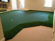 I like the idea that if there isn't enough room for a dedicated putting area, you just make a whole section of the floor a putting green.