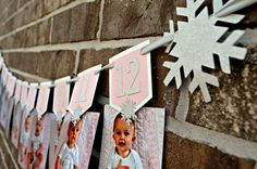 Winter Onederland/Snowflake first year photo banner! Display photos from newborn through 12 months! Made from premium glitter silver card stock, white and light pink matte card stock, and silver satin ribbon. Frozen First Birthday, First Birthday Winter, Winter Birthday Parties, First Birthday Photos, Girl First Birthday, Winter Onederland Party Girl 1st Birthdays, Winter Wonderland Birthday, Birthday Picture Banner, Foto Banner