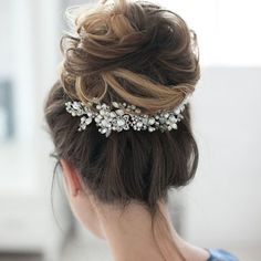 The perfect amount of glam to this #updo with @enzebridal stunning bridal accessories! Hair: @tonyastylist #weddinginspo