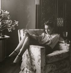 Olivia de Havilland by Bob Landry, chilling at home with a beer and a smoke in 1942.