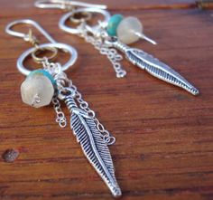 Free Spirit earrings. Rainbow Moonstones and turquoise dangle beside antique silver feathers and sterling silver chain.. $25.00, via Etsy.