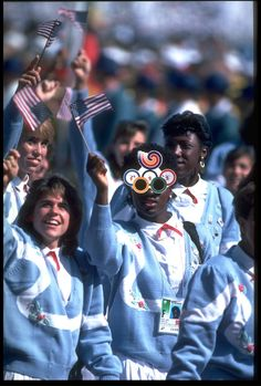 US Olympic Team in the Opening Ceremony, Seoul 1988. Powder blue sweaters with roses, button-down blouses, red ribbons, white pleated pants... the outfit seems like kind of a miss - but love the glasses!