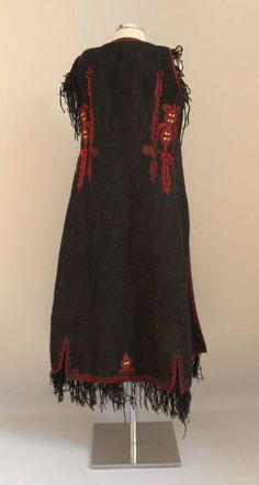 Sleeveless black overcoat made of fulled wool with tan,. Greek Traditional Dress, Greek Costumes, Black Overcoat, Greek Art, Albania, Shawls And Wraps, Vests, Folk Art, Greece