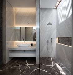 Indonesian PJ House created by Rakta Studio to feel like an ultra-modern vacation home every day Bathroom Wall Panels, Bathrooms Remodel, House, Modern Bathroom Lighting, Modern House Design, Bathroom Remodel Cost, Modern, Elegant Bathroom, Modern Bathroom Design