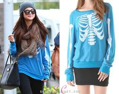 Selena Gomez was 'papped' today on a shopping spree with friend Francia Raisa, wearing a Wildfox Couture Inside Out Baggy Beach Sweatshirt in color Cerulean. This sweatshirt is sold out in most stores, however DollsKill.com has it on clearance for $63.00.  Buy it HERE.  She's also wearing an Urban Outfitters scarf and carrying her Dolce and Gabbana handbag.