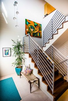 Show off interesting angles with a smartly designed stairwell. via Dwellingz