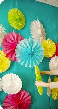 Fabric backdrop (orange or green) with pinwheels hanging in front