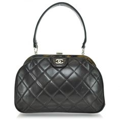 4b4927afc5dd19 This is an authentic CHANEL CHANEL Vintage Lambskin Quilted Handbag in  Black. This stylish tote