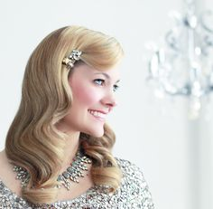 After you purchase your authentic vintage or Jenny Packham wedding gown, you'll need this throwback-glam hairstyle to match. Click here to learn how to do it.