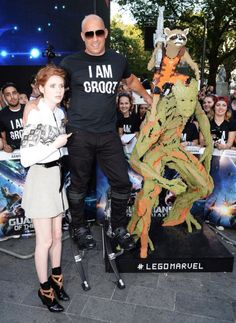 Vin Diesel at the Guardians of the Galaxy premiere on stilts, with Groot and Rocket Raccoon made out of Lego!