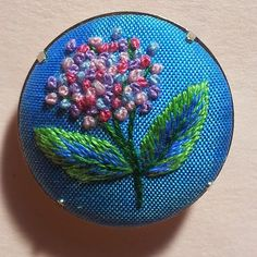 Margaret Dier Embroidery. Hydrangea embroidered in french knots and long and short.