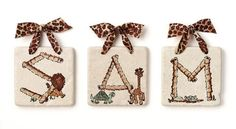 """Personalized Name Tiles - Safari Guide - Rough Stone by Jamie's Painting & Design. $14.00. These Personalized Safari Guide Rough Stone Name Tiles say a little extra with their personalized touch. Using original, hand-painted designs, each 4x4"""" rough tile is individually hand-finished and personalized with a letter of the child's name. The original animal artwork is heat-sealed into each tile, ensuring a high-quality finish and a long-lasting keepsake. The tiles come with coor..."""