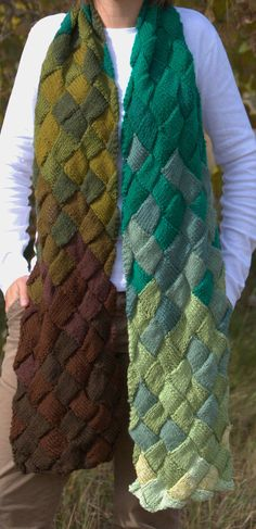 I love the variations of colors in this! Neat idea. Spring Entrelac Scarf Hand Knit