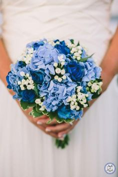 Wedding Bouquet with blue flowers | Santorini Wedding | Destination Wedding by Stella and Moscha - Exclusive Greek Island Weddings | Photo by George Pahountis