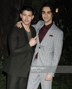 Alex Wolff and Nick Jonas at the Jumanji Premiere.
