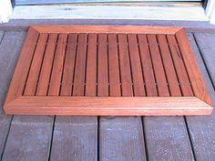 Make a wood doormat by Steve Ramsey Made from just one 2 x 6 x 8' redwood board, 2 metal rods, a handful of plastic spacers and 8 screws!