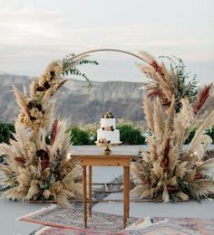 Cliffside Winery Wedding in Santorini with Romantic Pampas Grass Decor - Green W. Cliffside Winery Wedding in Santorini with Romantic Pampas Grass Decor - Green Wedding Shoes Wedding Props, Diy Wedding, Wedding Ceremony, Dream Wedding, Wedding Ideas, Wedding Cakes, Wedding Planning, Wedding Sweets, Ceremony Arch