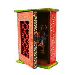 This ethnic rectangular box cum key holder is made of wood. It is adorned with handcrafted designs. It can be used as a key ring holder as well as a decoration piece to beautify your house.