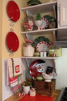 Candy themed christmas kitchen - note vintage bottle tree in milkglass. I also love the peppermint dishes w/the green 'leaf' plates.