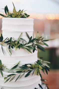white tier wedding cake with real olive leaves | utah indian fusion wedding | romantic indian wedding inspiration