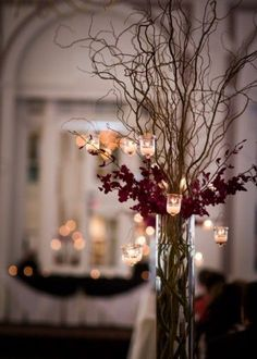 Curly willow, cylinder vase, hanging lights