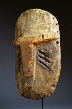 Ethnic group: Yela, Mbole Country of origin : D.R. Congo Material : Wood, pigment Approximate age : Early 20th Century Dimensions: 14in x 8.5in (35.5 cm x 22 cm)